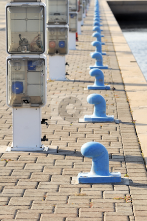 Marina stock photo, Rows of bitts and power and water connections by Massimiliano Leban