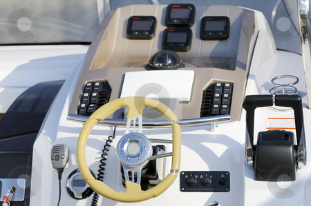 Motorboat cockpit stock photo, Instruments panel and steering wheel of a motorboat by Massimiliano Leban