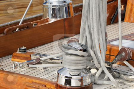 Sailboat deck stock photo, Detail of nautical tools on a wooden boat by Massimiliano Leban