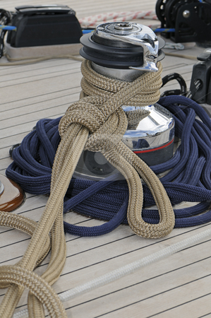 Sailboat detail stock photo, Ropes wrapped on a winch of a sailboat by Massimiliano Leban