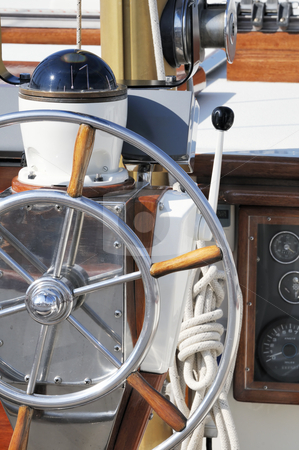 Nautical instruments stock photo, Detail of a wooden sailboat deck with rudder and compass by Massimiliano Leban