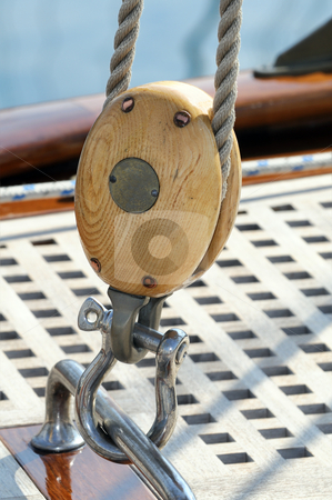 Sailing block stock photo, Close-up of a wooden pulley on a sailboat by Massimiliano Leban