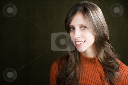 Prett Young Woman stock photo, Pretty young woman wearing an orange sweater by Scott Griessel