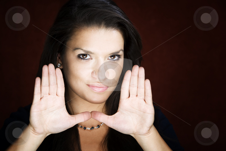 Pretty woman framing her face stock photo, Pretty woman framing her face with her hands by Scott Griessel
