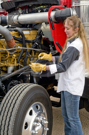 Woman doing pre-trip inspection. stock photo, A driver doing her pre-trip inspection prior to leaving. by RCarner Photography
