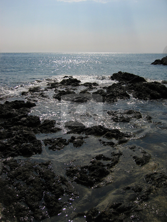 Rocky shore stock photo,  by Wolfgang Heidasch