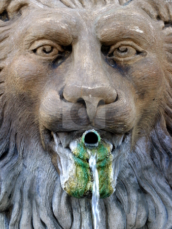 Lion Fountain stock photo, Weathered water fountain with a lion theme. by Henrik Lehnerer