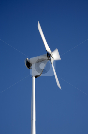 Small electricity generating wind turbine spinning with motion blur movement. stock photo, Small electricity generating wind turbine spinning with motion blur movement. by Stephen Rees