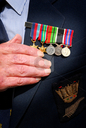 Medal pride stock photo, A world war 2 veteran with hand on heart and medals. by Greg Ward