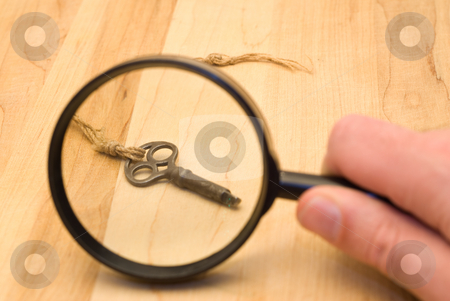 Mysterious Key stock photo, An old strange key that was found, placed under a magnifying glass by Richard Nelson
