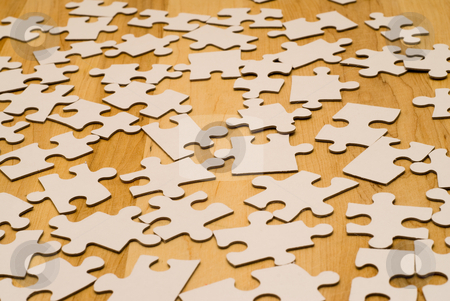 Incomplete Puzzle stock photo, An incomplete puzzle shot against a wooden background by Richard Nelson