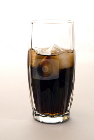 Cold Glass Of Pop stock photo, A cold glass of pop shot on white by Richard Nelson