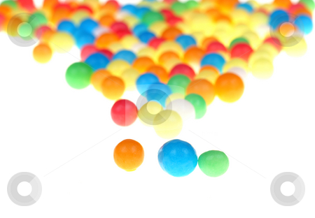 Candy stock photo, Colored candy on white background by Marek Kosmal