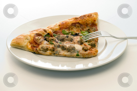 Supper stock photo, Some cold pizza on a plate along with a metal fork by Richard Nelson