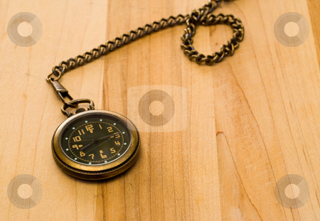 Old Pocket Watch stock photo, An old pocket watch with a chain, shot on a wooden table by Richard Nelson