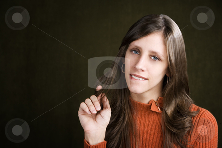 Pretty Young Woman Biting Her Lip stock photo, Pretty Young Woman Biting Her Lip and Twirling Her Hair by Scott Griessel