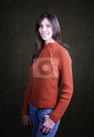 Pretty Young Woman stock photo, Pretty Young Woman Wearing an Orange Sweater and Wedding Ring by Scott Griessel