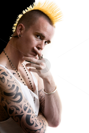 Man with Mohawk stock photo, Man with a tall yellow Mohawk hairstyle by Scott Griessel