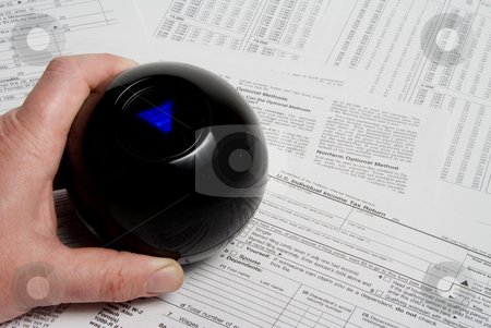 Filing an Income Tax Return stock photo, Using a magic ball to predict a tax return outcome. by Robert Byron