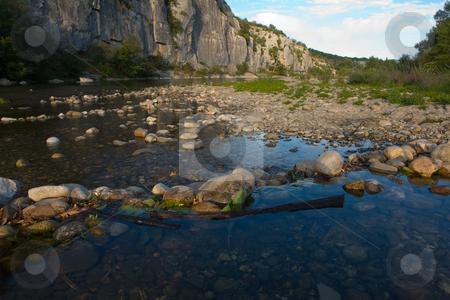River in Chassezac, Ardeche Valley, Southern France stock photo, Der Chassezac ist ein Zufluss der Ard?che in S?dfrankreich. Er entspringt in den Cevennen in der N?he von Le Moure de la Gardille. Bei Ruoms m?ndet er in die Ard?che. Typisch ist das steile Tal, welcher in den Jahrtausenden in den Stein gegraben hat. Fluss und Tal sind heute ein Eldorado f?r Kletterer und Kanufahrer. by Wolfgang Heidasch