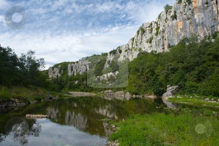 River and Cliffs in Chassezac, Ardeche Valley, Southern France stock photo, Der Chassezac ist ein Zufluss der Ard?che in S?dfrankreich. Er entspringt in den Cevennen in der N?he von Le Moure de la Gardille. Bei Ruoms m?ndet er in die Ard?che. Typisch ist das steile Tal, welcher in den Jahrtausenden in den Stein gegraben hat. Fluss und Tal sind heute ein Eldorado f?r Kletterer und Kanufahrer. by Wolfgang Heidasch