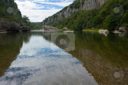 River in Cliffs in Chassezac, Ardeche Valley, Southern France stock photo, Der Chassezac ist ein Zufluss der Ard?che in S?dfrankreich. Er entspringt in den Cevennen in der N?he von Le Moure de la Gardille. Bei Ruoms m?ndet er in die Ard?che. Typisch ist das steile Tal, welcher in den Jahrtausenden in den Stein gegraben hat. Fluss und Tal sind heute ein Eldorado f?r Kletterer und Kanufahrer. by Wolfgang Heidasch