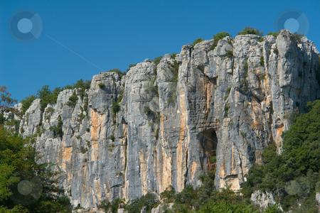 Rockface in Chassezac, Ardeche Valley, Southern France stock photo, Der Chassezac ist ein Zufluss der Ard?che in S?dfrankreich. Er entspringt in den Cevennen in der N?he von Le Moure de la Gardille. Bei Ruoms m?ndet er in die Ard?che. Typisch ist das steile Tal, welcher in den Jahrtausenden in den Stein gegraben hat. Fluss und Tal sind heute ein Eldorado f?r Kletterer und Kanufahrer. by Wolfgang Heidasch