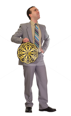 Winner stock photo, Full body view of a businessman holding a dartboard with three bullseyes, isolated against a white background by Richard Nelson