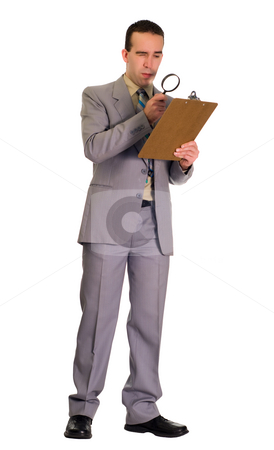 Man Inspecting Checklist stock photo, Full body view of a man inspecting a checklist with a magnifying glass, isolated against a white background by Richard Nelson