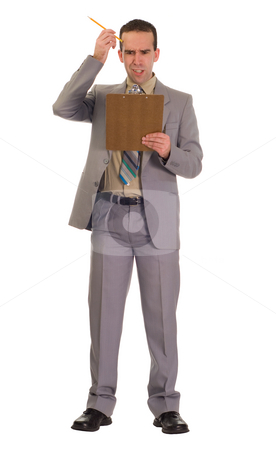 Businessman Scratching His Head stock photo, Full body view of a young businessman scratching his head while looking at his clipboard, isolated against a white background by Richard Nelson