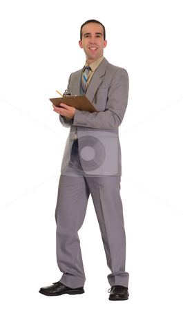 Businessman Doing Inventory stock photo, Full body view of a young businessman holding a clipboard and doing inventory by Richard Nelson