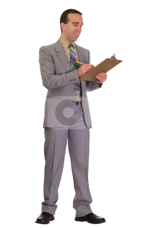 Businessman Doing Checklist stock photo, Full body view of a young businessman working on a checklist on a clipboard, isolated against a white background by Richard Nelson