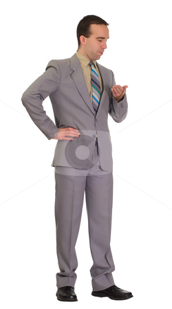 Businessman Waiting stock photo, Full-length view of a businessman waiting and looking at his pocket watch by Richard Nelson