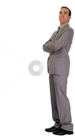 Businessman Leaning  stock photo, Full-length portrait of a young businessman leaning against a wall by Richard Nelson