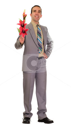 Loving Man stock photo, A loving man wearing a suit is holding some lilies by Richard Nelson