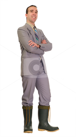 Businessman In Hot Water stock photo, Full body view of a businessman wearing a suit and rubber boots, isolated against a white background by Richard Nelson