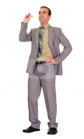 Businessman Throwing Darts stock photo, Full body view of a businessman throwing a dart, isolated against a white background by Richard Nelson