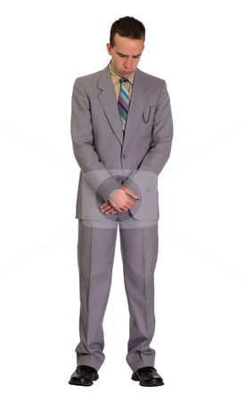 Praying Man stock photo, Full length view of a man bowing his head to pray, isolated against a white background by Richard Nelson