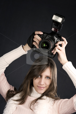 Pretty Photographer stock photo, Pretty photographer with a professional camera and flash by Scott Griessel