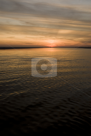 Sunset Seascape stock photo, Sunset over a sandbar with ripples in the water by A Cotton Photo