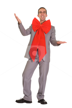 Business Present stock photo, Young businessman giving himself away as a Christmas present by Richard Nelson