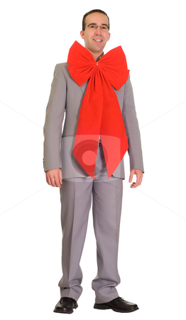 Nerdy Businessman stock photo, A nerdy businessman wearing a large red bow, isolated against a white background by Richard Nelson