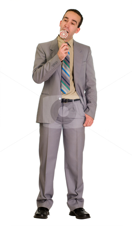 Businessman Eating Candy stock photo, Full body view of a businessman pretending to eat some fake candy by Richard Nelson