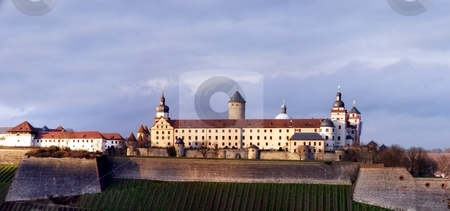 Festung Marienberg stock photo, Festung Marienberg on a hill over the city Wuerzburg by Henrik Lehnerer
