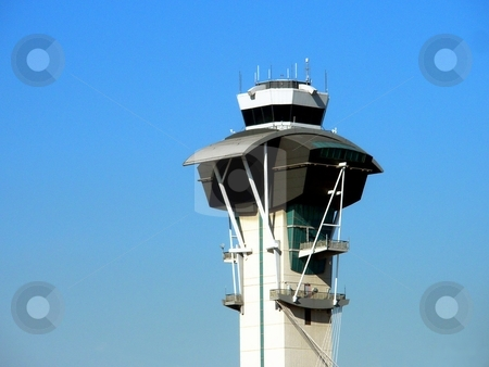 Control Tower stock photo, Control Tower at an airport with blue sky in background. by Henrik Lehnerer