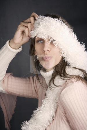 Pretty Woman with a Fuzzy Scarf stock photo, Pretty woman posing with a kiss and a fuzzy scarf by Scott Griessel