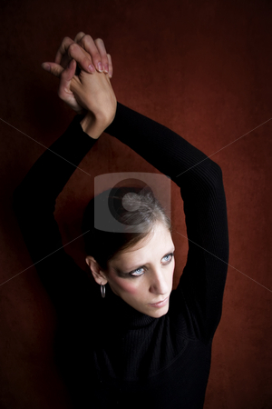 Beautiful Woman in a Black Dress stock photo, Beautiful Woman with in black hands above her head by Scott Griessel