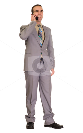 Businessman Talking On Cell Phone stock photo, Full body view of a young businessman talking on a cell phone, isolated against a white background by Richard Nelson