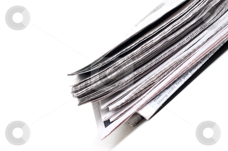 End view of a newspaper stock photo, Tilted view of the end view of a folder newspaper by Vince Clements