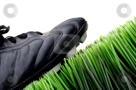 Cleat on green grass stock photo, Cleat on green grass by Vince Clements